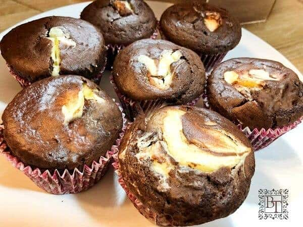 Chocolate muffins stuffed with cheesecake filling.