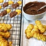 A close up photo of Viennese biscuits and a chocolate pot